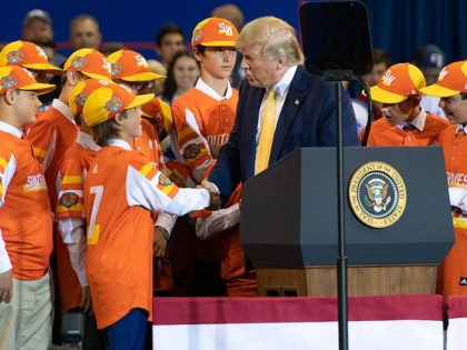 "US President Donald Trump (C) shakes hands with a member of the Little League World Championship baseball team, the Eastbank All Stars of Louisiana, during a ""Keep America Great"" rally at Sudduth Coliseum at the Lake Charles Civic Center in Lake Charles, Louisiana, on October 11, 2019. (Photo by SAUL …"