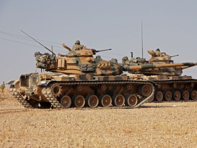 Turkish soldiers drive American-made M60 tanks in the town of Tukhar, north of Syria's northern city of Manbij, on October 14, 2019, as Turkey and its allies continue their assault on Kurdish-held border towns in northeastern Syria. - Syrian regime forces moved towards the Turkish border after Damascus reached a …