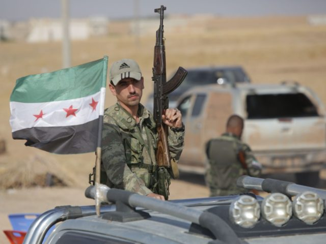 urkey-backed Syrian fighters take over areas on the road between Tal Abyad and Kobane on October 24, 2019, as Kurdish forces in northeastern Syria left several positions along the long border with Turkey, complying with a deal that sees Damascus, Ankara and Moscow carve up their now-defunct autonomous region. - …