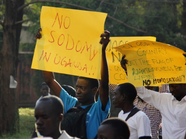 Anti-Homosexual activists march on the streets of Kampala carrying placards on August 11, 2014 to demonstrate against the recently annulled Anti-Gay law by Ugandas constitutional court. Ugandas attorney general has filed an appeal against the constitutional courts decision to overturn tough anti-gay laws, his deputy said on August 9. Branded …