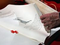 "A hand turns pages of a replica document of the trial 700 years ago, in which Pope Clement V absolved the Knights Templar of charges of heresy, is shown during the press conference presenting the ""Processus contro Templarios"", an exclusive edition book, 25 October 2007 at the Vatican. Some 799 …"