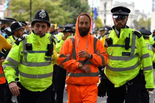 London police begin clearing climate protests