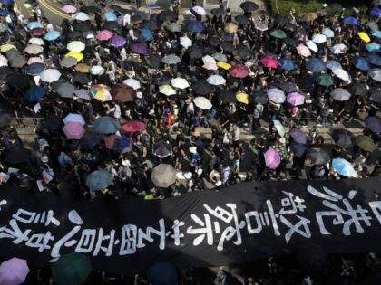Hong Kongers defy police with unauthorized protest