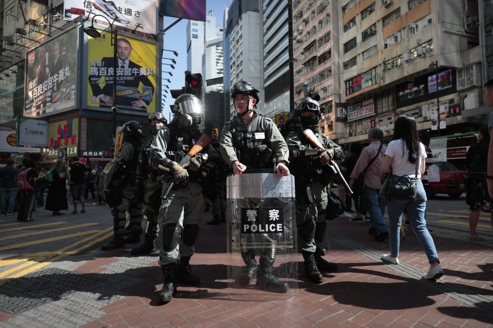 """Police officers in riot gear stand guard before an anti-government protest in Hong Kong, Saturday, Nov. 2, 2019. As Hong Kong continues on with its fifth month of anti-government protests, China vowed Friday to prevent foreign powers from interfering in Hong Kong's affairs and carrying out acts of """"separatism, subversion, infiltration and sabotage."""" (AP Photo/Dita Alangkara)"""