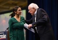 DES MOINES, IA - NOVEMBER 09: U.S. Rep. Alexandria Ocasio-Cortez (D-NY) is joined on stage by Democratic Presidential candidate Bernie Sanders (I-VT) during the Climate Crisis Summit at Drake University on November 9, 2019 in Des Moines, Iowa. Sanders, Ocasio-Cortez, and author Naomi Klein spoke about the current state of …