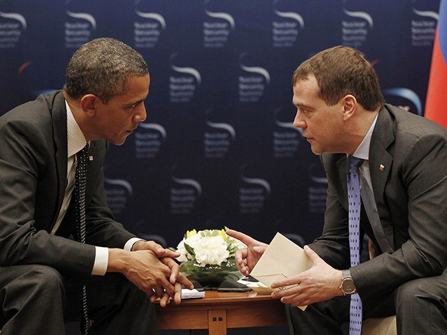 U.S. President Barack Obama, left, and Russian President Dmitry Medvedev chat during a bilateral meeting at the Nuclear Security Summit in Seoul, South Korea, Monday, March, 26, 2012. (AP Photo/Pablo Martinez Monsivais)