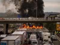 National police disperse pro-independence demonstrators blocking a major highway near Girona, Spain, Wednesday, Nov.13, 2019. Hundreds of car and truck drivers were stuck Wednesday in a large traffic jam in northeastern Spain caused by Catalan separatists blocking a major highway near the city of Girona. (AP Photo/Emilio Morenatti)