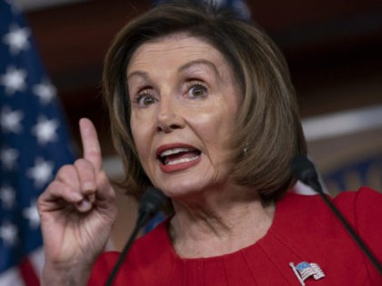 Speaker of the House Nancy Pelosi, D-Calif., talks to reporters on the morning after the first public hearing in the impeachment probe of President Donald Trump on his effort to tie U.S. aid for Ukraine to investigations of his political opponents, on Capitol Hill in Washington, Thursday, Nov. 14, 2019. …