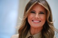 "First lady Melania Trump smiles during an event to pack ""comfort kits"" to be sent to troops overseas for the holidays, Wednesday, Nov. 20, 2019, at The American Red Cross National Headquarters in Washington. (AP Photo/Jacquelyn Martin)"