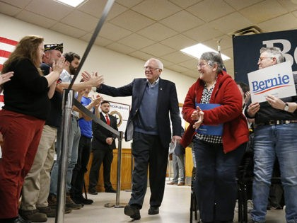 Democratic presidential candidate Sen. Bernie Sanders, I-Vt., high-fives supporters as he is introduced during a campaign stop, Sunday, Nov. 24, 2019, in Hillsboro, N.H. (AP Photo/Mary Schwalm)