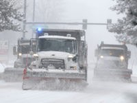 City of Denver snowplows clear the eastbound lanes of Speer Blvd. as a storm packing snow and high winds sweeps in over the region Tuesday, Nov. 26, 2019, in Denver. Stores, schools and government offices were closed or curtailed their hours while on another front, Thanksgiving Day travellers were forced …