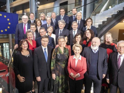 European Commission President Ursula von der Leyen, third right, and Frans Timmermans, second right, first vice-President of the European Commission, pose for a family photo with European Commissioners at the European Parliament Wednesday, Nov. 27, 2019 in Strasbourg, eastern France. Ursula von der Leyen told the EU plenary in Strasbourg, …
