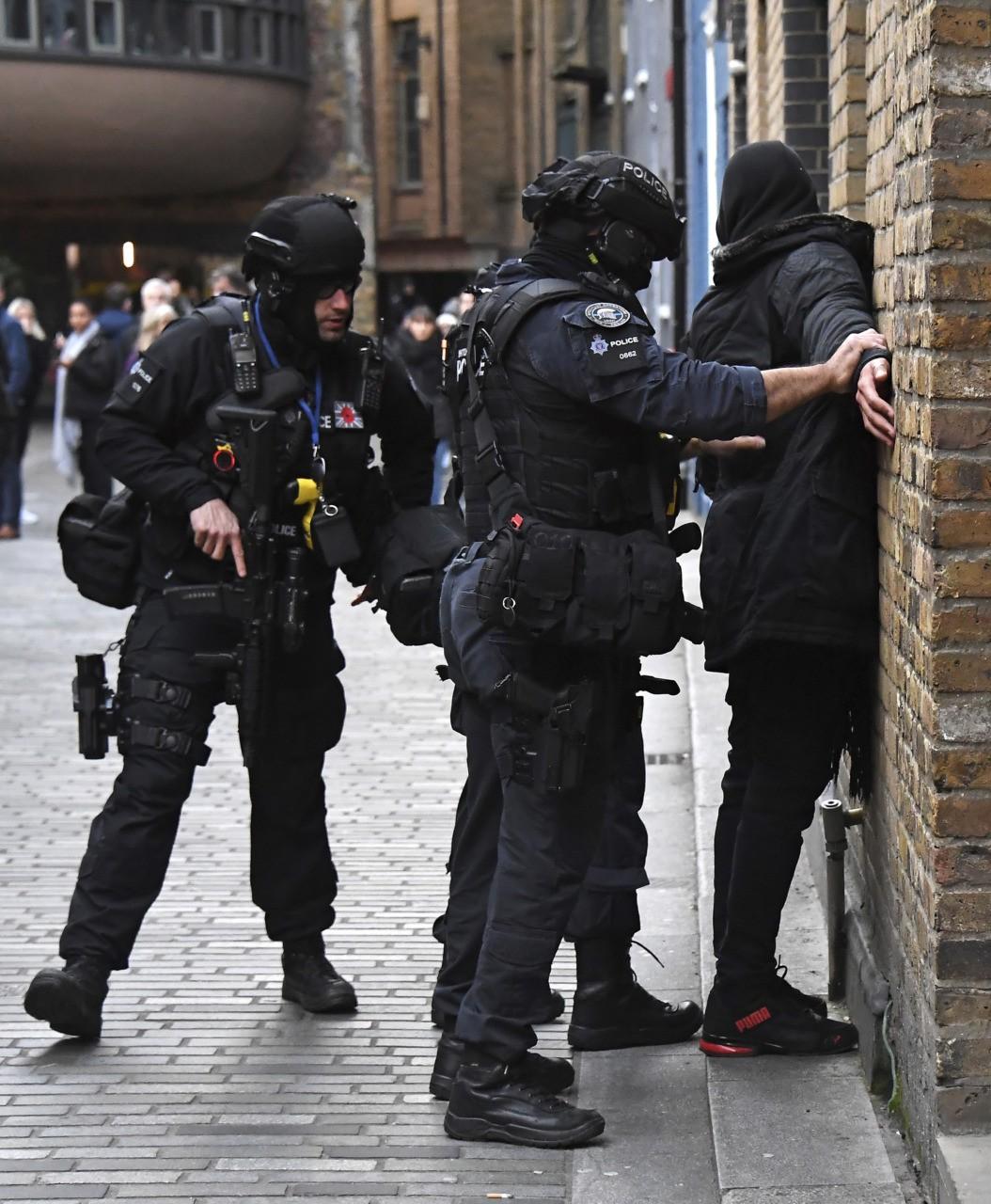 AP 19333557396863 - Police Shoot Knifeman, Several Injured