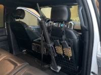 Greyman Tactical's Rigid Molle Panels (RMP) for vehicles let you keep your AR-15 or other favorite rifle close at hand while traveling.