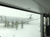 Chicago Fire Department on scene after a plane skidded off runway at O' Hare. (Credit: Luis Torres Curet)