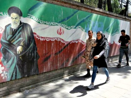 Iranians walk by the former US embassy in Tehran. Atta Kenare/AFP/Getty Images