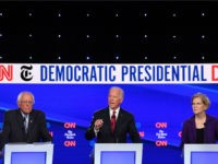 Democratic president hopefuls Vermont Senator Bernie Sanders (L) and Massachusetts Senator Elizabeth Warren (R) look on as former US Vice President Joe Biden speaks during the fourth Democratic primary debate of the 2020 presidential campaign season co-hosted by The New York Times and CNN at Otterbein University in Westerville, Ohio …