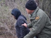 McAllen Station Border Patrol agent apprehends migrant woman left in the near freezing wet brush for 12 hours. (File Photo: Bob Price/Breitbart Texas)