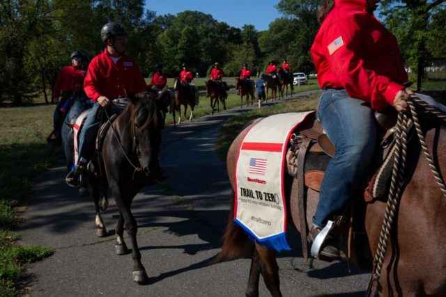 "Veterans take part in BraveHearts ""Trail to Zero"" ride on horseback at Arlington Cemetery in Virginia, on September 7, 2019. - ""Trail to Zero"" aims to raise awareness suicide prevention among veterans. (Photo by Alastair Pike / AFP) (Photo credit should read ALASTAIR PIKE/AFP via Getty Images)"