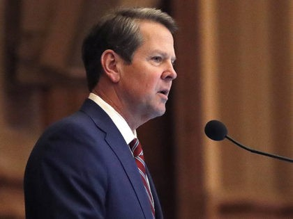 FILE - In this April 2, 2019, file photo, Georgia Gov. Brian Kemp, right, speaks to members of the Georgia House during the final 2019 legislative session at the state Capitol in Atlanta. A lawsuit challenging Georgia's election system can move forward, a judge ruled Thursday, May 30, in the …