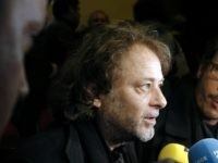 "French director Christophe Ruggia (L) and French actor reda Kateb address the media within the launching of ""The Appeal of Calais"", an initiative by French directors to raise awareness on the situation of migrants in the camp of Calais, on October 21, 2015 at the Louxor movie theater in Paris. …"