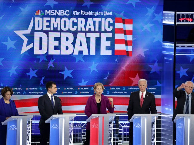 Democratic presidential hopefuls Mayor of South Bend, Indiana, Pete Buttigieg (L), Massachusetts Senator Elizabeth Warren (C) and Former Vice President Joe Biden speak during the fifth Democratic primary debate of the 2020 presidential campaign season co-hosted by MSNBC and The Washington Post at Tyler Perry Studios in Atlanta, Georgia on …