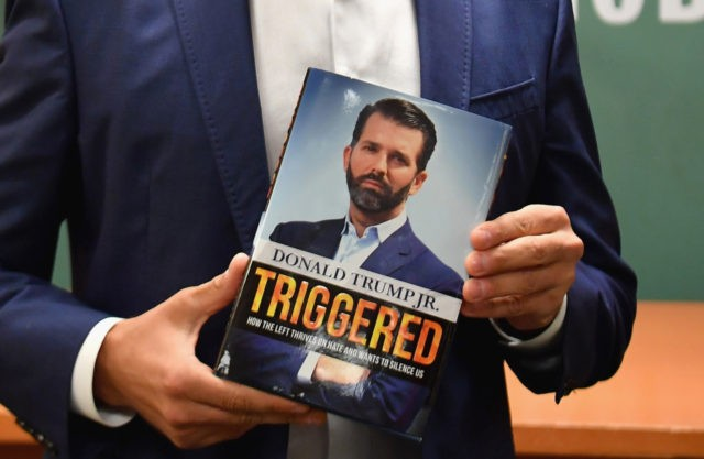 "Donald Trump Jr., holds his new Book ""Triggered: How the Left Thrives on Hate and Wants to Silence Us"" at Barnes & Noble on 5th Avenue on November 5, 2019 in New York. (Photo by Angela Weiss / AFP) (Photo by ANGELA WEISS/AFP via Getty Images)"