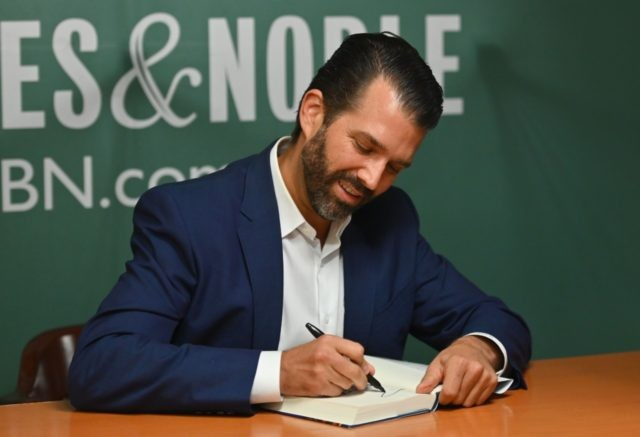 "Donald Trump Jr., signs his new Book ""Triggered: How the Left Thrives on Hate and Wants to Silence Us"" at Barnes & Noble on 5th Avenue on November 5, 2019 in New York. (Photo by Angela Weiss / AFP) (Photo by ANGELA WEISS/AFP via Getty Images)"