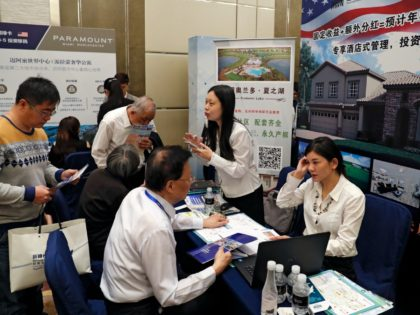 Chinese visitors seek information of the U.S. government's EB-5 visa program at the exhibitor booths in a Invest in America Summit, a day after an event promoting EB-5 investment in a Kushner Companies development held at a hotel in Beijing, Sunday, May 7, 2017. The sister of President Donald Trump's …