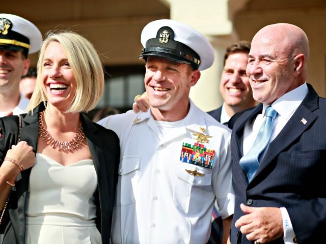 SAN DIEGO, CA - JULY 02:R, Navy Special Operations Chief Edward Gallagher celebrates with his wife Andrea after being acquitted of premeditated murder at Naval Base San Diego July 2, 2019 in San Diego, California. Gallagher was found not guilty in the killing of a wounded Islamic State captive in …