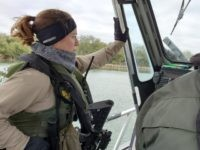 A female riverine Border Patrol agent stands watch during a shift on the Rio Grande. (Photo: Bob Price/Breitbart Texas)