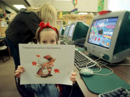 First-grader Kyleanne Kopping, 6, holds up a Thanksgiving picture she made on a computer at the April Lane Elementry School in Yuba City, Calif., Tuesday, Nov. 16, 1999. April Lane is starting an ambitious state program aimed at boosting student performance by the year 2002.(AP Photo/Rich Pedroncelli)