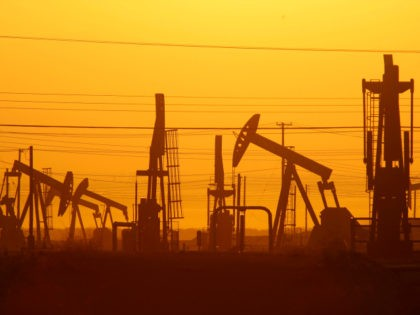 Pump jacks are seen at dawn in an oil field over the Monterey Shale formation where gas and oil extraction using hydraulic fracturing, or fracking, is on the verge of a boom on March 24, 2014 near Lost Hills, California. Critics of fracking in California cite concerns over water usage …