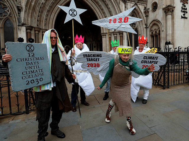 British fashion designer Vivienne Westwood, dressed as an angel, poses with other anti-fracking activists, dressed as Joseph, and the three wise men, as the demonstrate outside the Royal Courts of Justice, Britain's High Court, in central London on December 18, 2018. - Anti-fracking activists, including Talk Fracking, of which Westwood …
