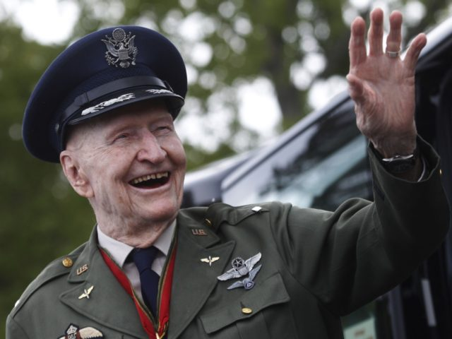 Former Berlin Airlift pilot Gail Halvorsen from the US waves as he arrives to attend a ceremony at the Tempelhofer Feld, a former airfield in Berlin, on May 11, 2019. - The Berlin Braves sports club dedicated their baseball and softball fields to Gail Halvorsen on the sidelines of the …