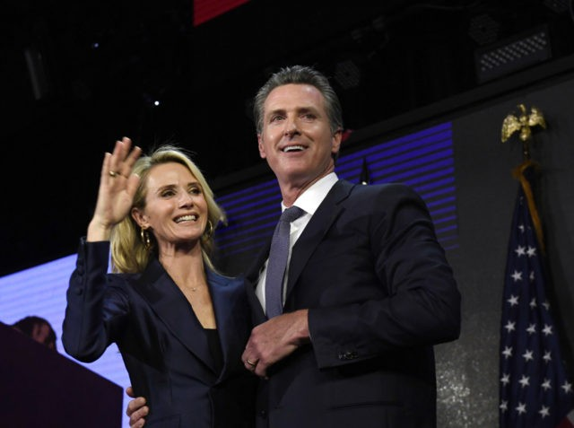 LOS ANGELES, CA - NOVEMBER 06: Democratic gubernatorial candidate Gavin Newsom and his wife Jennifer Siebel Newsom wave to supporters during election night event on November 6, 2018 in Los Angeles, California. (Photo by Kevork Djansezian/Getty Images)