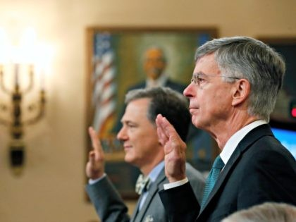 Top U.S. diplomat in Ukraine William Taylor, right, and career Foreign Service officer George Kent, left are sworn in to testify before the House Intelligence Committee on Capitol Hill in Washington, Wednesday, Nov. 13, 2019, during the first public impeachment hearing of President Donald Trump's efforts to tie U.S. aid …