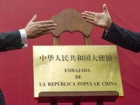 Minister of Foreign Affairs and State Counselor of the People's Republic of China, Wang Yi (R) and the Dominican Republic Foreign Minister Miguel Vargas Maldonado (L), shake hands during the inauguration ceremony of the Chinese Embassy in Santo Domingo, on September 21, 2018. - Wang Yi is in Dominican Republic …