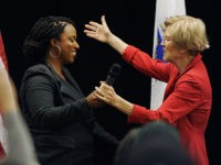 Massachusetts Democratic congressional candidate Ayanna Pressley (L) greets US Senator Elizabeth Warren (D-MA) during a town hall meeting in Roxbury, Massachusetts, October 13, 2018. (Photo by Joseph PREZIOSO / AFP) (Photo credit should read JOSEPH PREZIOSO/AFP via Getty Images)