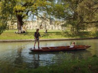 CAMBRIDGE, UNITED KINGDOM - APRIL 19: Members of the public punt along the river Cam in front of the colleges of Cambridge University on April 19, 2011 in Cambridge, England. The UK is currently basking in fine weather with the Met Office predicting temperatures up to 25C this week. The …