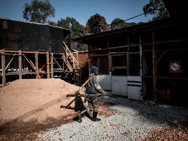 A soldier from the Armed Forces of the Democratic Republic of the Congo (FARDC) patrols inside an Ebola Treatment Centre (ETC) in Butembo, the epicentre of DR Congo's latest Ebola outbreak, after it was attacked on March 9, 2019. - Mai-Mai rebels attacked the ETC in the early hours of …