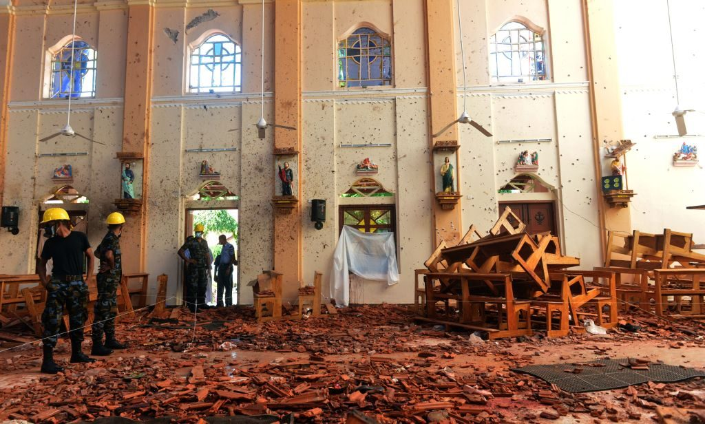Security personnel inspect the interior of St. Sebastian's Church in Negombo on April 22, 2019, a day after the church was hit in series of bomb blasts targeting churches and luxury hotels in Sri Lanka. - The death toll from bomb blasts that ripped through churches and luxury hotels in Sri Lanka rose dramatically April 22 to 290 -- including dozens of foreigners -- as police announced new arrests over the country's worst attacks for more than a decade. (Photo by ISHARA S. KODIKARA / AFP) (Photo credit should read ISHARA S. KODIKARA/AFP via Getty Images)