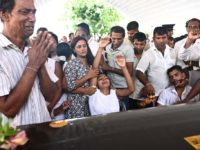 Relatives mourn beside a coffin of a bomb blast victim during a funeral service at St Sebastian's Church in Negombo on April 23, 2019, two days after a series of bomb attacks targeting churches and luxury hotels in Sri Lanka. - Sri Lanka began a day of national mourning on …