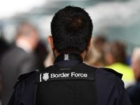 A member UK Border Force patrols at Heathrow Airport in London on July 16, 2019, part of Operation Limelight, a national multi-agency safeguarding operation at the UK border that focuses on harmful practices. - In collaboration with Border Force, specialist officers from the Met's Continuous Policing Improvement Command will be …