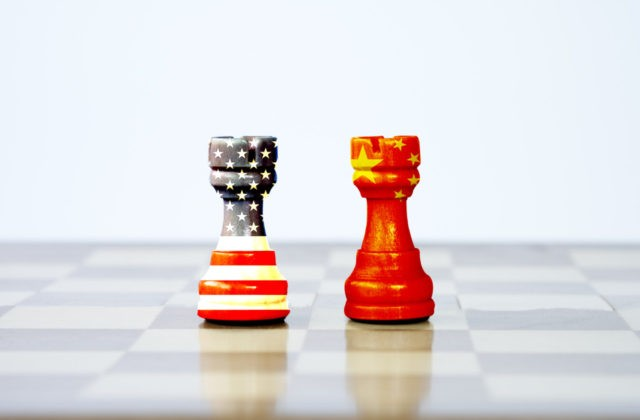 USA flag and China flag print screen on chess with white background.It is symbol of tariff trade war tax barrier between United States of America and China.-Image.