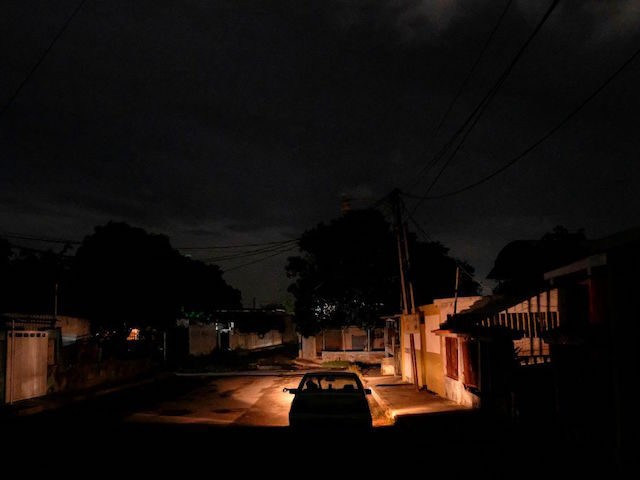 "A car is seen on a street during a power cut in Maracaibo, Venezuela on August 15, 2019. - Venezuelans from outside the capital see Caracas as a ""paradise"", since electricity is not rationed there and in their hometowns they are used to suffering 12-hour blackouts. (Photo by Matias Delacroix …"