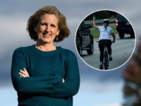 Juli Briskman, who was fired after giving US President Donald Trump's motorcade the middle finger while cycling and is running for a seat on the Loudoun County Board of Supervisors, poses October 17, 2019, in Sterling, Virginia. - Two years later, Briskman has jumped headfirst into politics and is running …