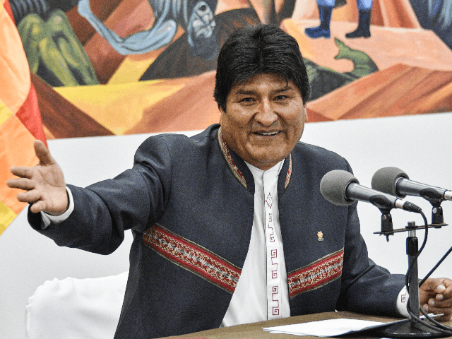 Bolivia's President and presidential candidate Evo Morales gestures during a press conference at the Casa Grande del Pueblo (Great House of the People) in La Paz, on October 24, 2019. - Evo Morales said Thursday he was open to holding a second round run-off in Bolivia's presidential elections, despite claiming …