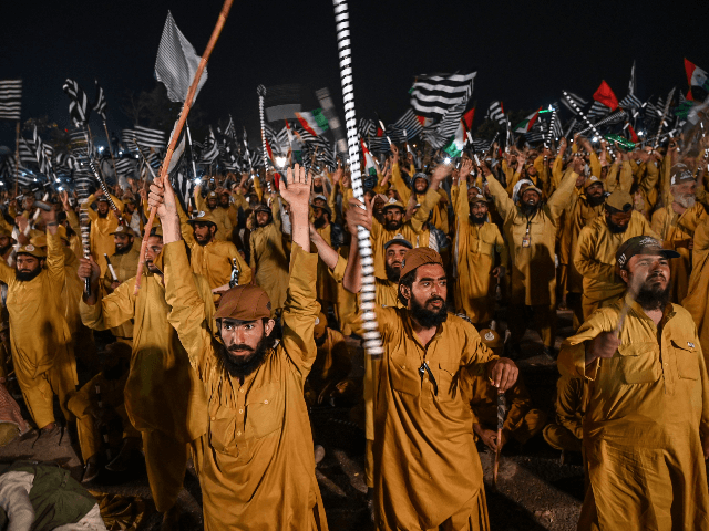 "Supporters of Islamic political party Jamiat Ulema-e-Islam (JUI-F) react as they listen to the speech of their leader Maulana Fazlur Rehman during an anti-government ""Azadi (Freedom) March"" in Islamabad on November 1, 2019. - Thousands of Islamists rallied in Islamabad on November 1 as several huge marches from across Pakistan …"