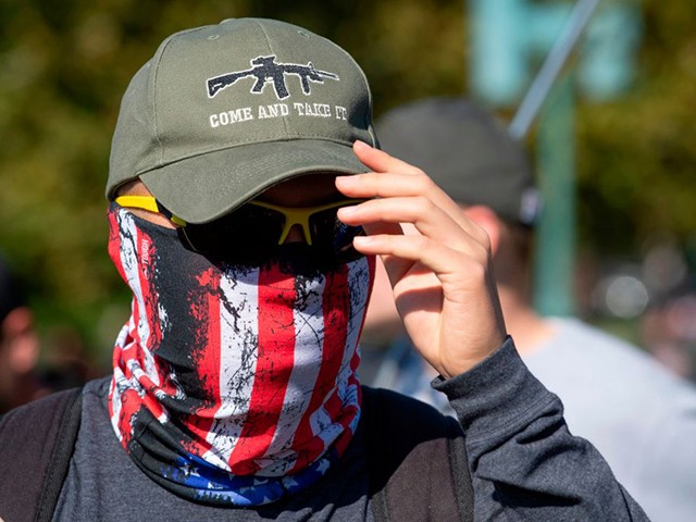 """A pro-gun supporter attends a rally in favor of the 2nd Amendment in front of the US Capitol on November 2, 2019, in Washington, DC. - The 2nd Amendment to the US Constitution reads, """"A well-regulated militia, being necessary to the security of a free state, the right of the people to keep and bear arms, shall not be infringed."""" (Photo by Roberto SCHMIDT / AFP) (Photo by ROBERTO SCHMIDT/AFP via Getty Images)"""